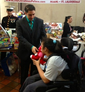 Jesus Salas Giving Toys to beautiful children
