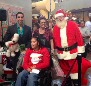 Jesus Zeus Salas toy giveaway with Chair Commissioner Rebeca Sosa of Miami Dade County