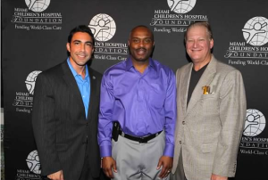 Co Chairs Jesus Salas and John Agnetti with Tim Hardaway